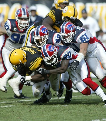 PITTSBURGH - SEPTEMBER 16:  Najeh Davenport #44 of the Pittsburgh Steelers is tackled by Donte Whitner #20, Paul Posluszny #51 and Jim Leonard #42 of the Buffalo Bills at Heinz Field September 16, 2007 in Pittsburgh, Pennsylvania. Pittsburgh won 26-3.  (P