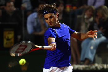ROME, ITALY - MAY 11:  Roger Federer of Switzerland plays a forehand during his second round match against Jo-Wilfried Tsonga of France during day four of the Internazoinali BNL D'Italia at the Foro Italico Tennis Centre on May 11, 2011 in Rome, Italy.  (