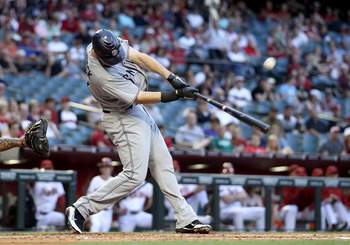 PHOENIX, AZ - MAY 16:  Ryan Ludwick #47 of the San Diego Padres hits a RBI sacrifice fly against the Arizona Diamondbacks during the first inning of the Major League Baseball game at Chase Field on May 16, 2011 in Phoenix, Arizona.  (Photo by Christian Pe