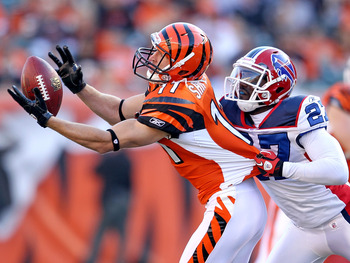 CINCINNATI - NOVEMBER 21:  Jordan Shipley #11 of the Cincinnati Bengals reaches for a pas while defended by Reggie Corner #27 of the Buffalo Bills during the NFL game  at Paul Brown Stadium on November 21, 2010 in Cincinnati, Ohio.  The Bills won 49-31.