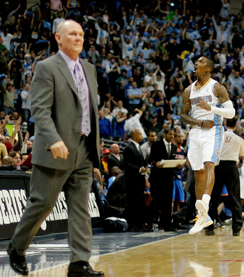 DENVER, CO - APRIL 25:  J.R. Smith #5 of the Denver Nuggets celebrates a three point basket as head coach George Karl walks onto the court for a timeout against the Oklahoma City Thunder in Game Four of the Western Conference Quarterfinals in the 2011 NBA