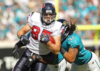 JACKSONVILLE, FL - NOVEMBER 14:  Joel Dreessen  #85 of the Houston Texans runs the ball before being tackled by Austen Lane #92 during a game against the Jacksonville Jaguars at EverBank Field on November 14, 2010 in Jacksonville, Florida.  (Photo by Mike