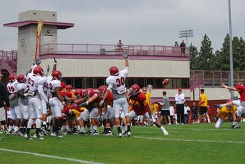 PK Andre Heidari kicking against broomsticks in spring practice