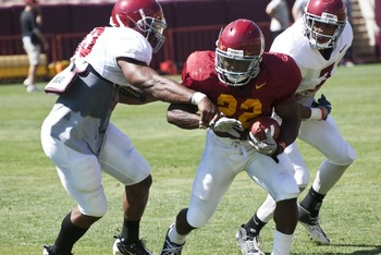 RB Curtis McNeal breaks tackle during spring practice