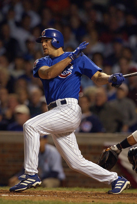 CHICAGO - OCTOBER 7:  Shortstop Alex Gonzalez #8 of the Chicago Cubs hits a home run in the sixth inning of game one of the National League Championship Series against the Florida Marlins on October 7, 2003 at Wrigley Field in Chicago, Illinois. The Marli
