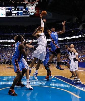 DALLAS, TX - MAY 17:  Russell Westbrook #0 of the Oklahoma City Thunder shoots over Tyson Chandler #6 of the Dallas Mavericks in the second half in Game One of the Western Conference Finals during the 2011 NBA Playoffs at American Airlines Center on May 1