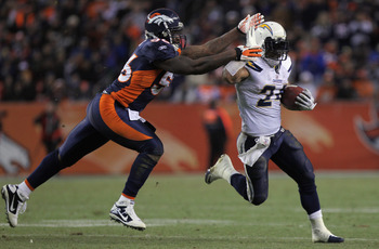 DENVER - JANUARY 02:  Running back Ryan Mathews #24 of the San Diego Chargers eludes linebacker Robert Ayers #56 of the Denver Broncos as he rushes for a 31 yard touchdown on fourth down and one yard to go in the fourth quarter at INVESCO Field at Mile Hi