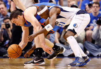 DALLAS, TX - MAY 17:  Nick Collison #4 of the Oklahoma City Thunder and Jason Terry #31 of the Dallas Mavericks battle for a loose ball in the first half in Game One of the Western Conference Finals during the 2011 NBA Playoffs at American Airlines Center
