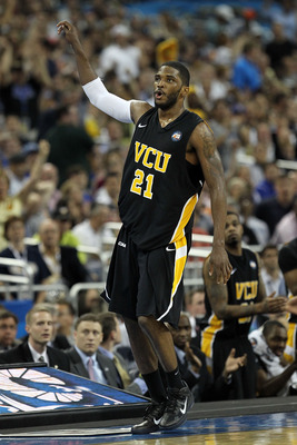 HOUSTON, TX - APRIL 02:  Jamie Skeen #21 of the Virginia Commonwealth Rams reacts after hitting a three pointer and drawing a foul against the Butler Bulldogs during the National Semifinal game of the 2011 NCAA Division I Men's Basketball Championship at