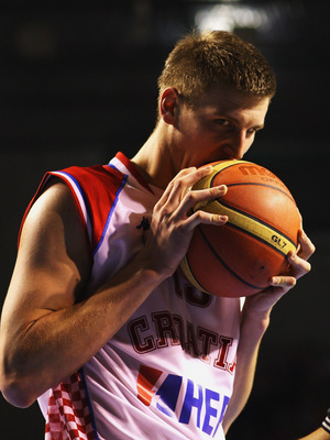 AUCKLAND, NEW ZEALAND - JULY 11:  Tomislav Zubcic of Croatia bites on the ball during the U19 Basketball World Championships Semi-Final match between Croatia and the United States of America at North Shore Events Centre on July 11, 2009 in Auckland, New Z