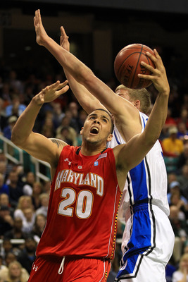 GREENSBORO, NC - MARCH 11:  Jordan Williams #20 of the Maryland Terrapins shoots against Mason Plumlee #5 of the Duke Blue Devils during the first half in the quarterfinals of the 2011 ACC men's basketball tournament at the Greensboro Coliseum on March 11