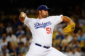 LOS ANGELES, CA - MARCH 31:  Jonathan Broxton #51 of the Los Angeles Dodgers throws a pitch in the ninth inning against the San Francisco Giants on Opening Day at Dodger Stadium on March 31, 2011 in Los Angeles, California.  (Photo by Kevork Djansezian/Ge
