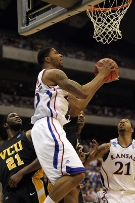 SAN ANTONIO, TX - MARCH 27:  Marcus Morris #22 of the Kansas Jayhawks goes to the basket against Jamie Skeen #21 of the Virginia Commonwealth Rams during the southwest regional final of the 2011 NCAA men's basketball tournament at the Alamodome on March 2