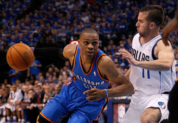 DALLAS, TX - MAY 17:  Russell Westbrook #0 of the Oklahoma City Thunder drives on Jose Juan Barea #11 of the Dallas Mavericks in the second quarter in Game One of the Western Conference Finals during the 2011 NBA Playoffs at American Airlines Center on Ma