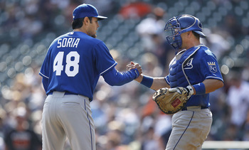 DETROIT, MI - APRIL 10:  Joakim Soria #48 of the Kansas City Royals celebrates beating the Detroit Tigers 9-5 with Matt Treanor #15 at Comerica Park on April 10, 2011 in Detroit, Michigan.  (Photo by Gregory Shamus/Getty Images)