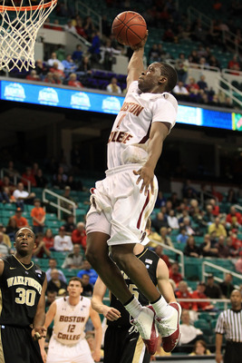 GREENSBORO, NC - MARCH 10:  Reggie Jackson #0 of the Boston College Eagles shoots against Travis McKie #30 of the Wake Forest Demon Deacons during the second half of the game in the first round of the 2011 ACC men's basketball tournament at the Greensboro