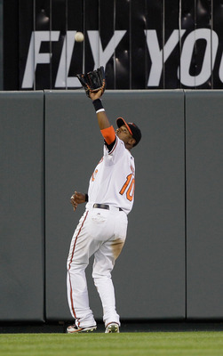 BALTIMORE, MD - MAY 12:  Center fielder Adam Jones #10 of the Baltimore Orioles makes a catch against the Seattle Mariners at Oriole Park at Camden Yards on May 12, 2011 in Baltimore, Maryland.  (Photo by Rob Carr/Getty Images)
