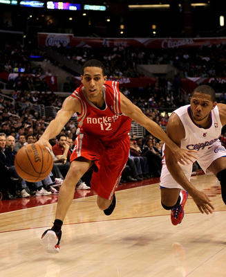 LOS ANGELES, CA - DECEMBER 22:  Kevin Martin #12 of the Houston Rockets reaches to control the ball in front of Eric Gordon #10 of the Los Angeles Clippers at Staples Center on December 22, 2010 in Los Angeles, California.  NOTE TO USER: User expressly ac