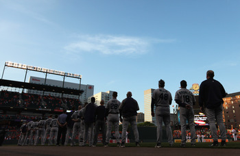 BALTIMORE, MD - MAY 12:  Members of the Seattle Mariners listen to the national anthem before the start of their game against the Baltimore Orioles at Oriole Park at Camden Yards on May 12, 2011 in Baltimore, Maryland.  (Photo by Rob Carr/Getty Images)