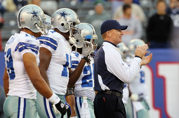 EAST RUTHERFORD, NJ - NOVEMBER 14:  Head coach Jason Garrett of the Dallas Cowboys works  with his team as they warm up prior to playing against the New York Giants on November 14, 2010 at the New Meadowlands Stadium in East Rutherford, New Jersey.  (Phot