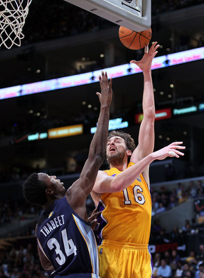 LOS ANGELES, CA - NOVEMBER 02:  Pau Gasol #16 of the Los Angeles Lakers drives over Hasheem Thabeet #34 of the Memphis Grizzlies during the game at Staples Center on November 2, 2010 in Los Angeles, California. The Lakers defeated the Grizzlies 124-105. N