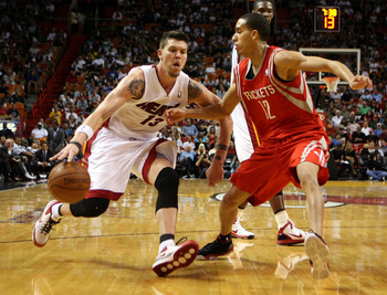 MIAMI, FL - MARCH 27:  Forward Mike Miller #13 of the Miami Heat drives against Forward Kevin Martin #12 of the Houston Rockets  at American Airlines Arena on March 27, 2011 in Miami, Florida. NOTE TO USER: User expressly acknowledges and agrees that, by