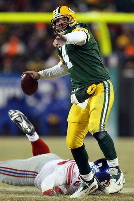 GREEN BAY, WI - JANUARY 20:  Quarterback Brett Favre #4 of the Green Bay Packers throws the ball during the NFC championship game against the New York Giants on January 20, 2008 at Lambeau Field in Green Bay, Wisconsin. The Giants defeated the Packers 23-
