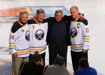 BUFFALO, NY - FEBRUARY 23:  New Buffalo Sabres owner Terry Pegula stands with former Sabres palyers Rene Robert #14, Rick Martin #7 and Gilbert Perrault #11  during pre game ceremonies prior to play against the Atlanta Thrashers at HSBC Arena on February