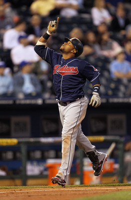 KANSAS CITY, MO - MAY 17:  Carlos Santana #41 of the Cleveland Indians points skyward as he crosses home plate after a solo home run during the 5th inning of the game against the Kansas City Royals on May 17, 2011 at Kauffman Stadium in Kansas City, Misso