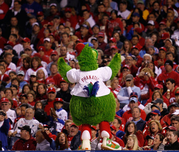 PHILADELPHIA - OCTOBER 17:  The Phillie Phanatic pumps up the crowd as the Phillies take on the San Francisco Giants in Game Two of the NLCS during the 2010 MLB Playoffs at Citizens Bank Park on October 17, 2010 in Philadelphia, Pennsylvania.  (Photo by J