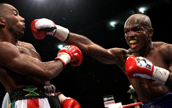 NOTTINGHAM, ENGLAND - MAY 10:  Timothy Bradley (R) throws a straight right against Junior Witter during their WBC Light Welterweight fight on May 10, 2008 at Nottingham Ice Arena in Nottingham, England. (Photo by John Gichigi/Getty Images)