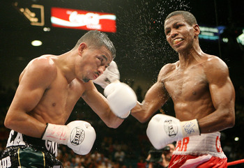 LAS VEGAS - JULY 26:  Cesar Canchila (R) hits Giovani Segura during their interim WBA light flyweight title fight at the MGM Grand Garden Arena July 26, 2008 in Las Vegas, Nevada. Canchila won by unanimous decision.  (Photo by Ethan Miller/Getty Images)