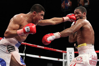 LAS VEGAS - DECEMBER 11:  (L-R) Victor Ortiz connects with a left to the face of Lamont Petersen during the super lightweight fight at Mandalay Bay Events Center on December 11, 2010 in Las Vegas, Nevada.  (Photo by Scott Heavey/Getty Images)