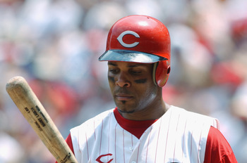 CINCINNATI - JULY 21:  Shortstop Barry Larkin #11 of the Cincinnati Reds examines his bat during the MLB game against the New York Mets on July 21, 2002  at Cinergy Field in Cincinnati, Ohio.  The Reds defeated the Mets 9-1. (Photo By Matthew Stockman/Get