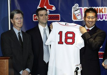 BOSTON - DECEMBER 14:  (L-R) Red Sox owner John Henry and general manager Theo Epstein present Daisuke Matsuzaka with his jersey during a press conference to announce that the pitcher has signed with the Boston Red Sox on December 14, 2006 at Fenway Park