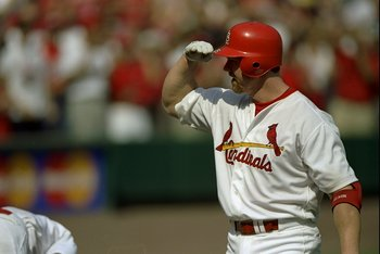 27 Sep 1998:  Mark McGwire #25 of the St. Louis Cardinals salutes a teammate after hitting his 70th home run of the season during a game against the Montreal Expos at Busch Stadium in St. Louis, Missouri. The Cardinals defeated the Expos 6-3. Mandatory Cr