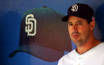 SAN DIEGO - MAY 27:  Pitcher Greg Maddux #30 of the San Diego Padres looks on from the dugout against the Milwaukee Brewers during their MLB game on May 27, 2007 at Petco Park in San Diego, California.  (Photo by Donald Miralle/Getty Images)