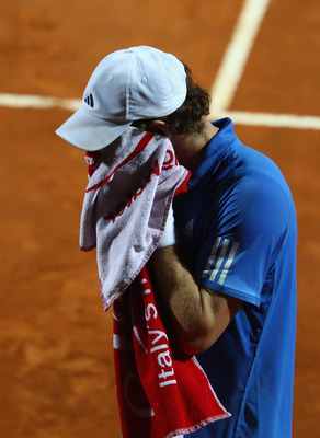 ROME, ITALY - MAY 14:  Andy Murray of Great Britain shows his dejection during his semi final match against Novak Djokovic of Serbia during day seven of the Internazoinali BNL D'Italia at the Foro Italico Tennis Centre  on May 14, 2011 in Rome, Italy.  (P