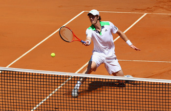 ROME, ITALY - MAY 13:  Andy Murray of Great Britain plays a forehand volley at the net during his quarter final match against Florian Mayer of Germany during day six of the Internazoinali BNL D'Italia at the Foro Italico Tennis Centre  on May 13, 2011 in