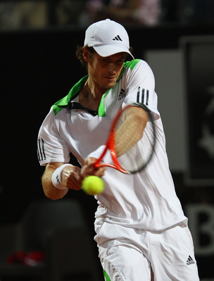 ROME, ITALY - MAY 14:  Andy Murray of Great Britain plays a backhand during his semi final match againstNovak Djokovic of Serbia during day seven of the Internazoinali BNL D'Italia at the Foro Italico Tennis Centre  on May 14, 2011 in Rome, Italy.  (Photo