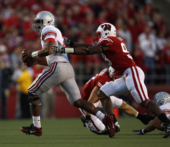 MADISON, WI - OCTOBER 16: Terrelle Pryor #2 of the Ohio State Buckeyes is chased by Louis Nzegwu #93 of the Wisconsin Badgers at Camp Randall Stadium on October 16, 2010 in Madison, Wisconsin. Wisconsin defeated Ohio State 31-18. (Photo by Jonathan Daniel