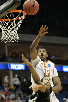 TULSA, OK - MARCH 18:  Tristan Thompson #13 of the Texas Longhorns blocks a shot by Reggie Hamilton #23 of the Oakland Golden Grizzlies during the second round game of the 2011 NCAA men's basketball tournament at BOK Center on March 18, 2011 in Tulsa, Okl