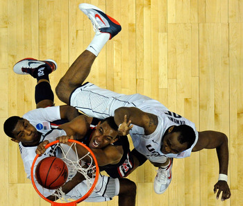 ANAHEIM, CA - MARCH 26:  Derrick Williams #23 of the Arizona Wildcats dunks the ball against Charles Okwandu #35 and Roscoe Smith #22 of the Connecticut Huskies during the west regional final of the 2011 NCAA men's basketball tournament at the Honda Cente