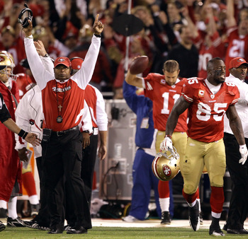SAN FRANCISCO - SEPTEMBER 20:  Vernon Davis #85 and head coach Mike Singletary of the San Francisco 49ers celebrate a two-point conversion ruling was reversed in their favor due to instant replay during their game against the New Orleans Saints at Candles