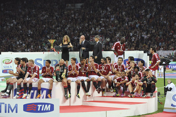 MILAN, ITALY - MAY 14:  Players of Milan during the awarding ceremony for the Italian Serie A championship after the Serie A match between AC Milan and Cagliari Calcio at Stadio Giuseppe Meazza on May 14, 2011 in Milan, Italy.  (Photo by Dino Panato/Getty