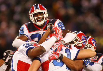 EAST RUTHERFORD, NJ - OCTOBER 18:  Paul Posluszny #51 of the Buffalo Bills is congradulated by teammate Ashton Youboty #26 after intercepting the ball in overtime against the New York Jets at Giants Stadium in the Meadowlands on October 18, 2009 in East R
