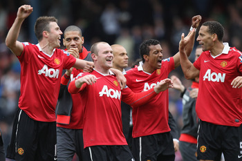 BLACKBURN, ENGLAND - MAY 14:  Michael Carrick (L),Chris Smalling (2L),Wayne Rooney (3L), Nani (2R) and Rio Ferdinand of Manchester United celebrate clinching the title during the Barclays Premier League match between Blackburn Rovers and Manchester United