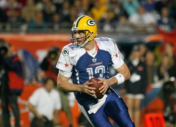 MIAMI GARDENS, FL - JANUARY 31:  Aaron Rodgers #12 of the NFC's Green Bay Packers scrambles out of the pocket during the 2010 AFC-NFC Pro Bowl game at Sun Life Stadium on January 31, 2010 in Miami Gardens, Florida. The AFC defeated the NFC 41-34. (Photo b