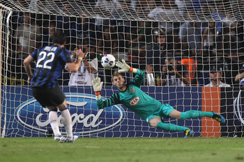 MONACO - AUGUST 27:  David de Gea of Atletico saves a penalty from Diego Milito of Inter during the UEFA Super Cup match between Inter Milan and Atletico Madrid at Louis II Stadium on August 27, 2010 in Monaco, Monaco.  (Photo by Michael Steele/Getty Imag