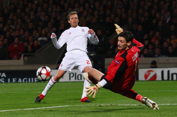 LYON, FRANCE - NOVEMBER 04:  Lucas (L) of Liverpool has his shot saved by Hugo Lloris (r) of Lyon during the Lyon v Liverpool UEFA Champions League Group E match at the Stade de Gerland on November 4, 2009 in Lyon, France.  (Photo by Michael Steele/Getty